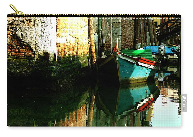 Venice Carry-all Pouch featuring the photograph Reflection Of The Wooden Boat by Donna Corless