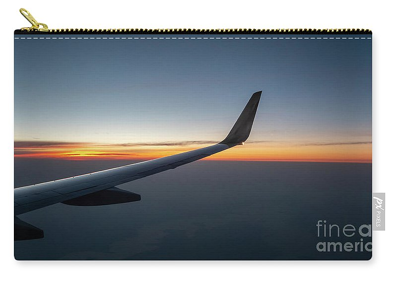 Usa Carry-all Pouch featuring the photograph Right Wing Of Airplane In Mid Air With Sunrise In The Background by PorqueNo Studios
