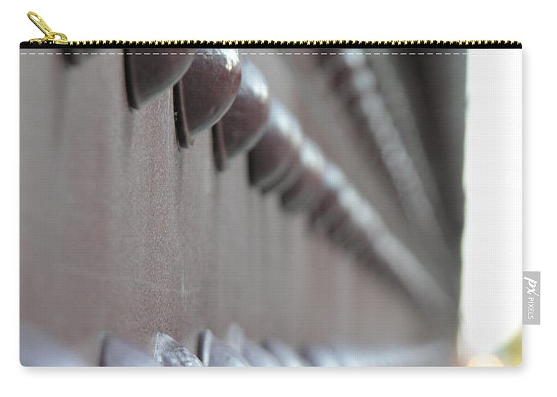 Rivets Carry-all Pouch featuring the photograph Rivets by Diane Greco-Lesser