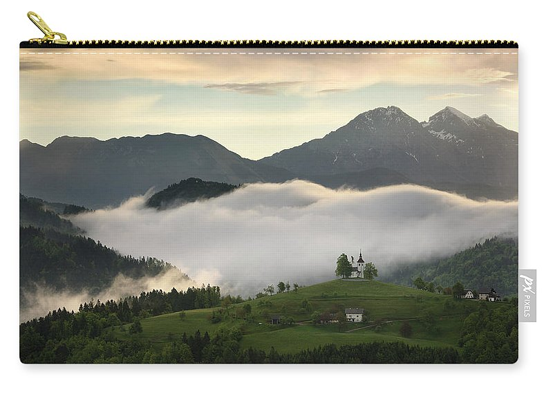 Sunrise Carry-all Pouch featuring the photograph Rolling Fog At Sunrise In The Skofjelosko Hills With St Thomas C by Reimar Gaertner
