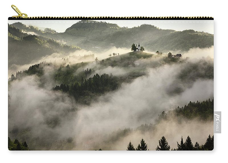 Sunrise Carry-all Pouch featuring the photograph Rolling Fog At Sunrise In The Skofjelosko Hribovje Hills With St by Reimar Gaertner