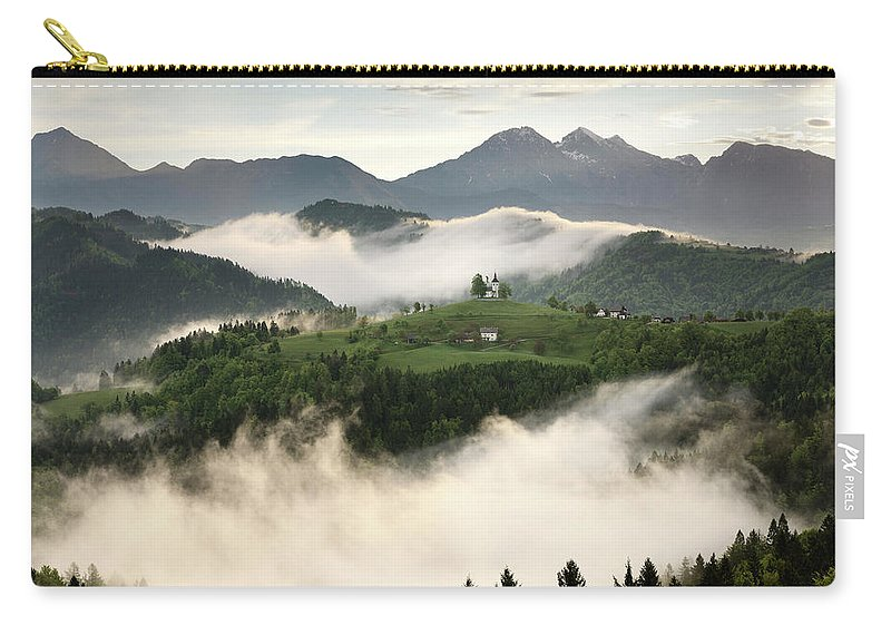 Sunrise Carry-all Pouch featuring the photograph Rolling Fog At Sunrise With Mountains Of Kamnik Savinja Alps At by Reimar Gaertner