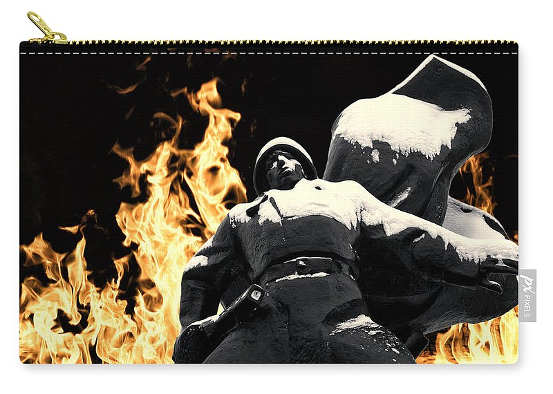 Soldier Statue Carry-all Pouch featuring the photograph Russian Soldier Statue In Snow And Fire by John Williams