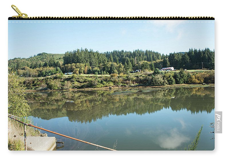 Reedsport Carry-all Pouch featuring the photograph Rusty Railing And Reflection by Tom Cochran
