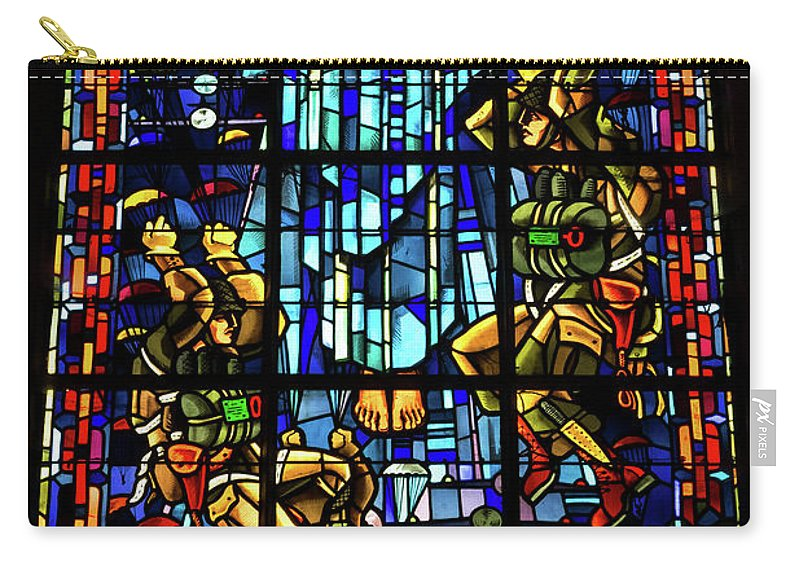 Sainte-mere-eglise Carry-all Pouch featuring the photograph Sainte-mere-eglise Paratrooper Tribute Stained Glass Window by John Daly