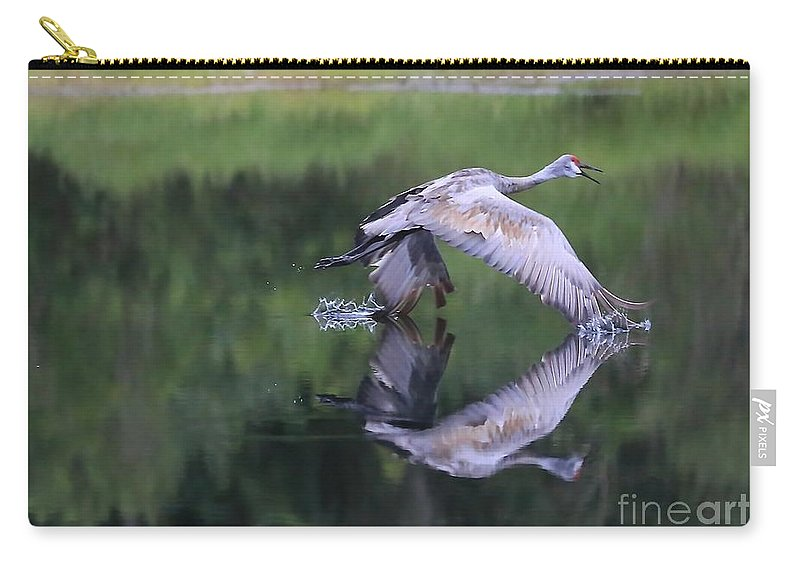 Sandhill Crane Carry-all Pouch featuring the photograph Sandhill Retreat by Carol Groenen
