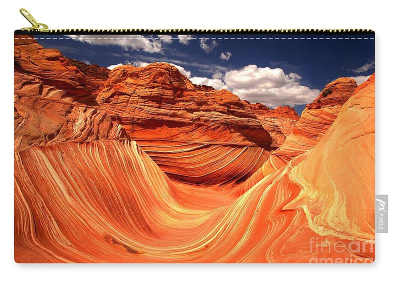 The Wave Carry-all Pouch featuring the photograph Sandstone Waves And Clouds by Adam Jewell