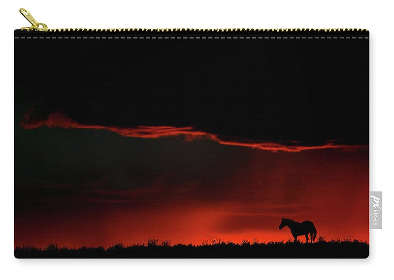 Horse Carry-all Pouch featuring the digital art Set Sun Silhouetting Horse On Saskatchewan Ridge by Mark Duffy