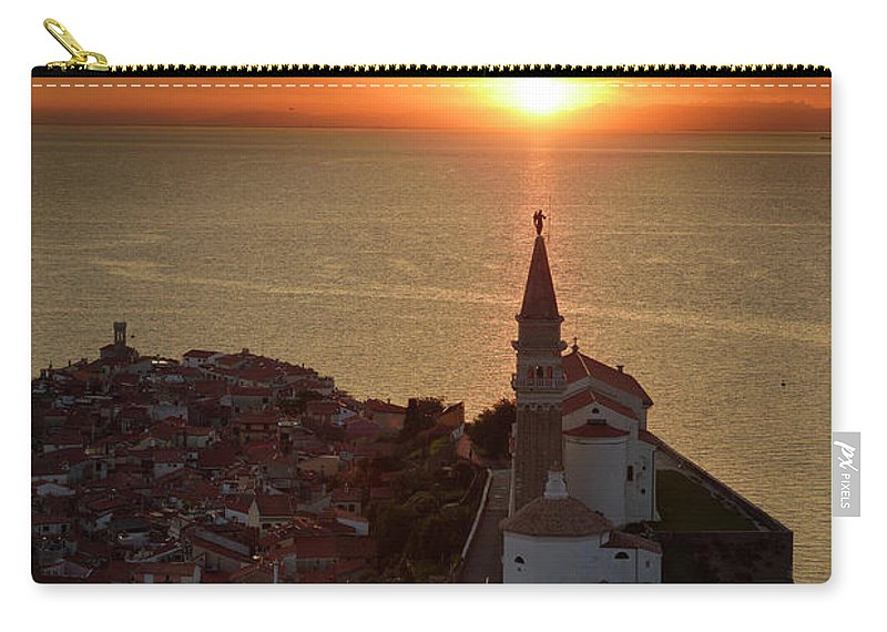 Setting Carry-all Pouch featuring the photograph Setting Sun On The Adriatic Sea Behind Archangel Michael On Top by Reimar Gaertner