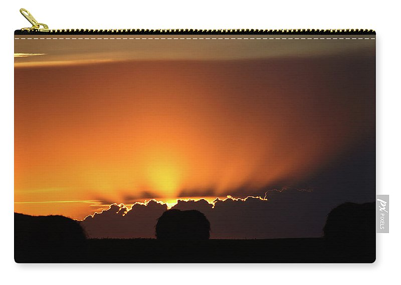 Sun Carry-all Pouch featuring the digital art Setting Sun Peaking Out From Storm Clouds In Saskatchewan by Mark Duffy
