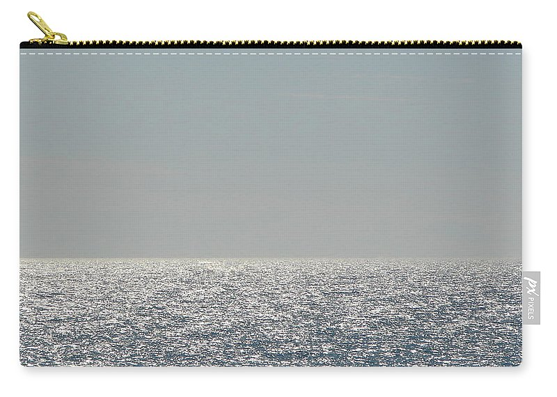 Blue Carry-all Pouch featuring the photograph Silver Light On Lake Michigan by Michelle Calkins