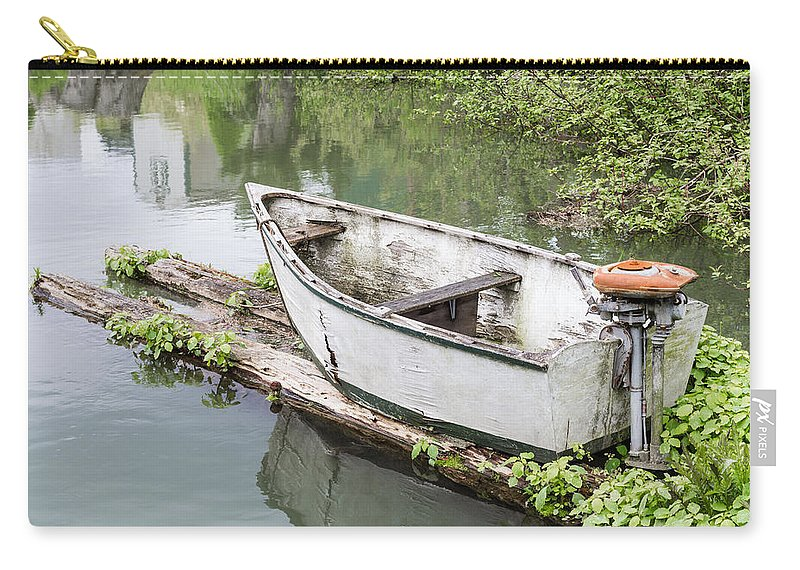 Boat Carry-all Pouch featuring the photograph Skiff And Motor by John Trax