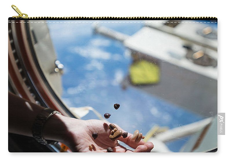 Satellite Carry-all Pouch featuring the photograph Snacking In Space by Science Source