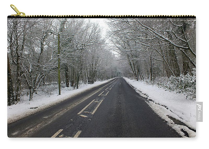 Snow Carry-all Pouch featuring the photograph Snow Covered Road by Dave Philp