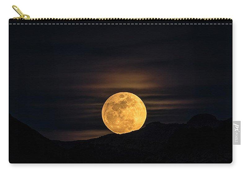 Snow Moon Carry-all Pouch featuring the photograph Snow Moon Rising by Saija Lehtonen