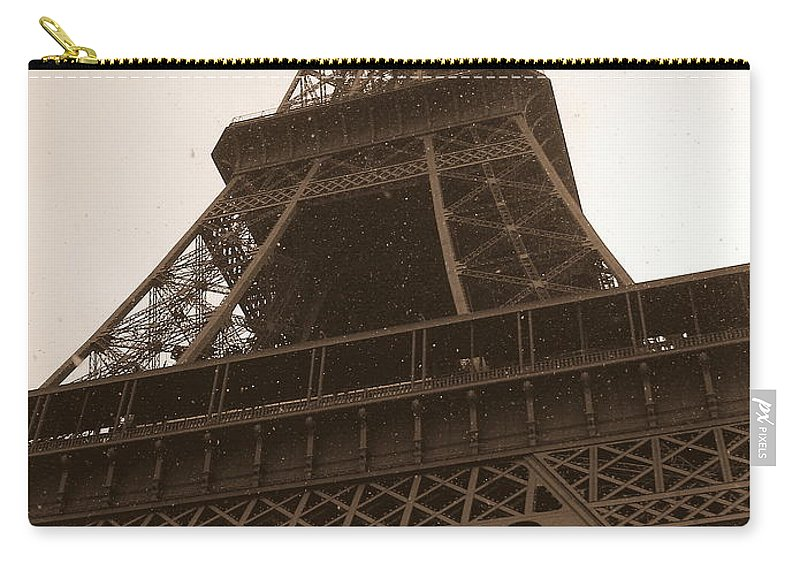 Paris Carry-all Pouch featuring the photograph Snowing On The Eiffel Tower by Carol Groenen