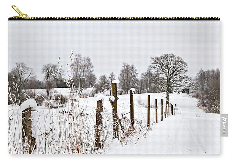 Tree Carry-all Pouch featuring the photograph Snowy Rural Landscape by Sophie McAulay