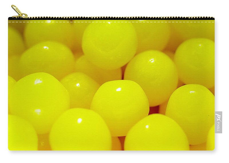 Candies Carry-all Pouch featuring the photograph Sour Lemon Candies by Kevin Gallagher