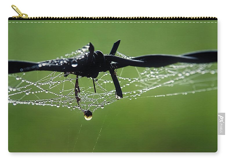 Web Carry-all Pouch featuring the photograph Spiderweb On Fencing by Susie Peek