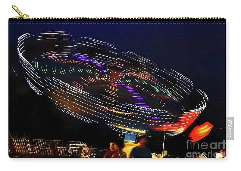 Spinning Lights Carry-all Pouch featuring the photograph Spinning Lights by Kaye Menner