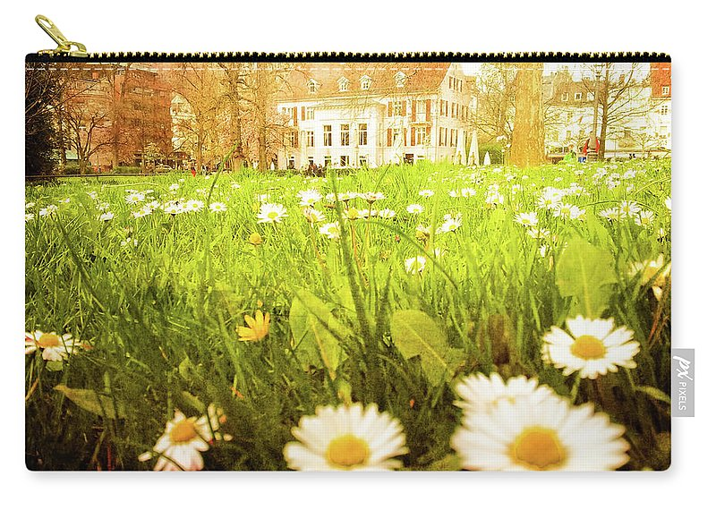 Gerlya Sunshine Carry-all Pouch featuring the photograph Spring. A Medow Spread With Daisies In Baden-baden, Germany by Gerlya Sunshine