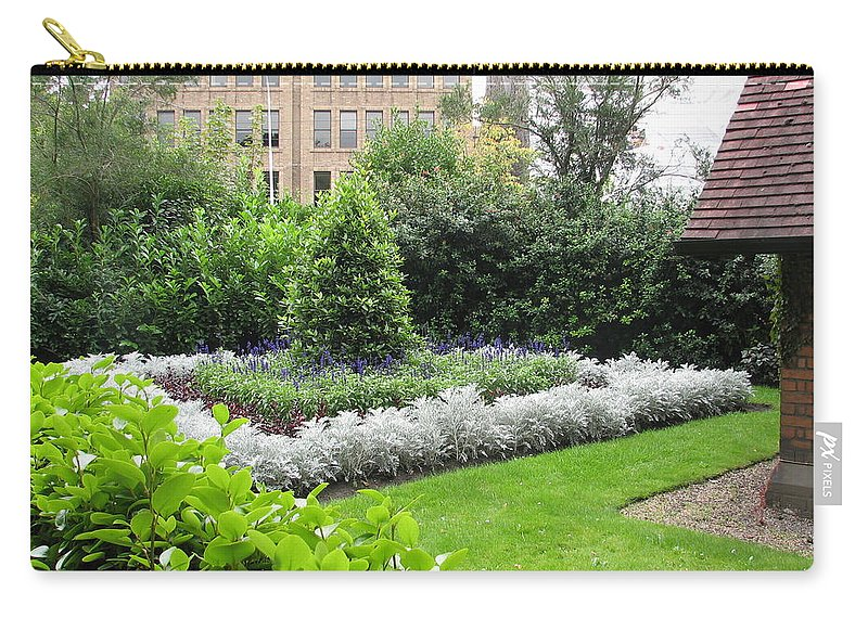 Ireland Carry-all Pouch featuring the photograph St. Stephen's Garden by Kelly Mezzapelle