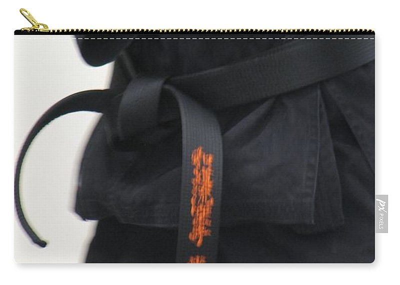 Karate Carry-all Pouch featuring the photograph Stands With Fist by Kelly Mezzapelle