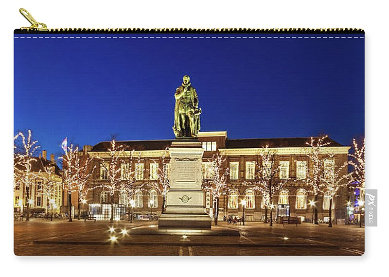 The Hague Carry-all Pouch featuring the photograph Statue Of William Of Orange On The Plein - The Hague by Barry O Carroll