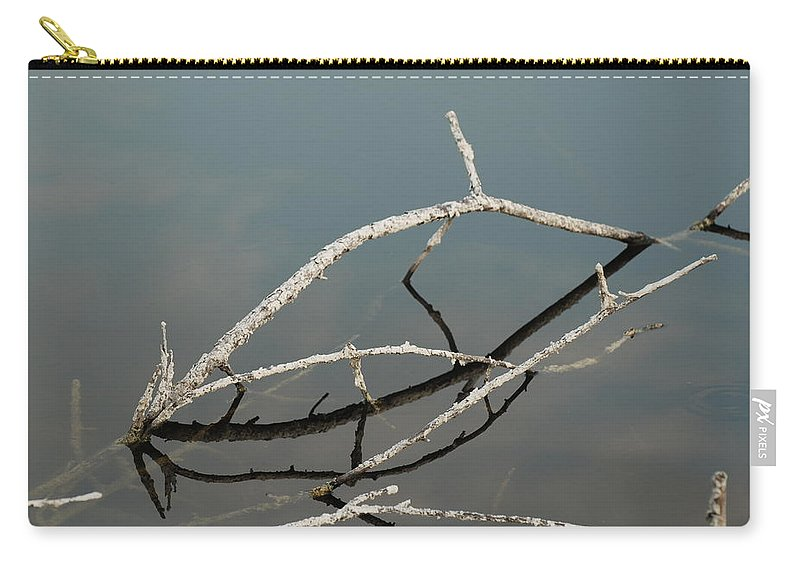Blue Carry-all Pouch featuring the photograph Sticks In The Water by Rob Hans