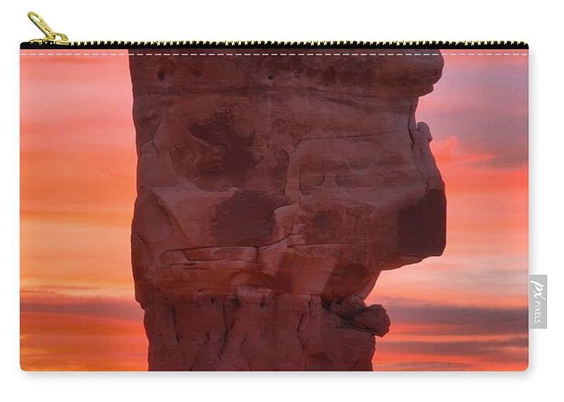 Devils Garden Carry-all Pouch featuring the photograph Stone Face Sunset by Adam Jewell