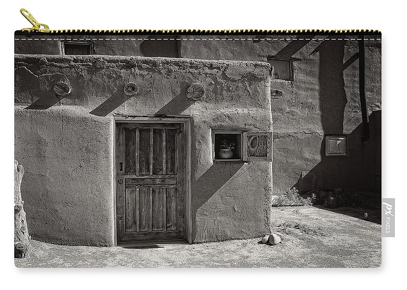 Carry-all Pouch featuring the photograph Stones And Trunk by Timothy Princehorn