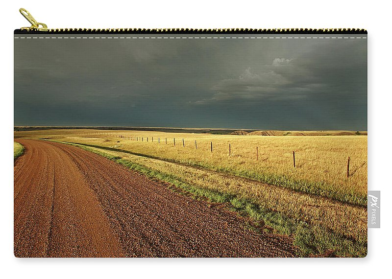 Roadside Carry-all Pouch featuring the digital art Storm Clouds Along A Saskatchewan Country Road by Mark Duffy