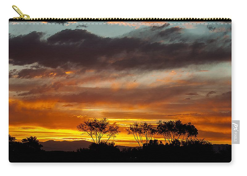Colorado Landscapes Carry-all Pouch featuring the photograph Stormy Sunset by John Bartelt