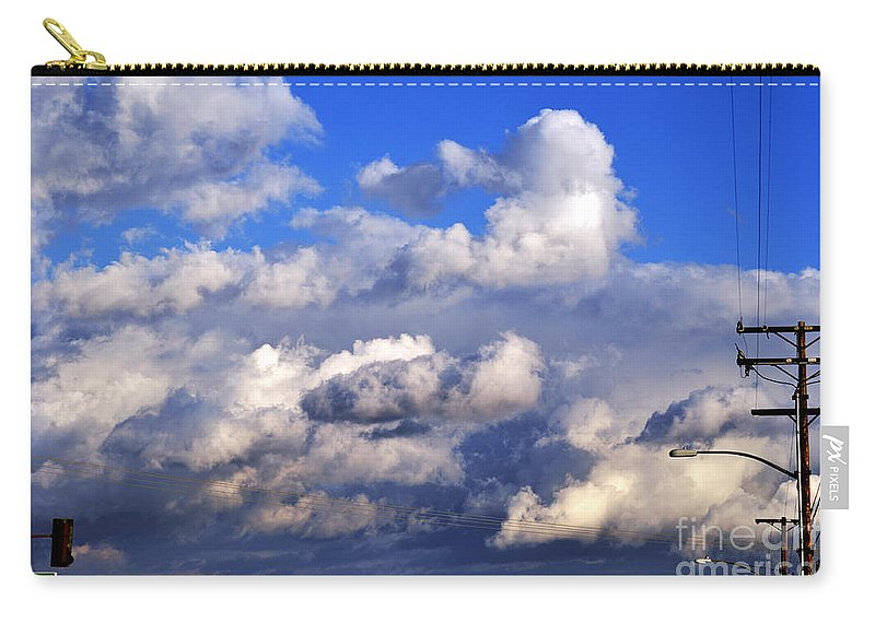 Clay Carry-all Pouch featuring the photograph Strange Clouds by Clayton Bruster