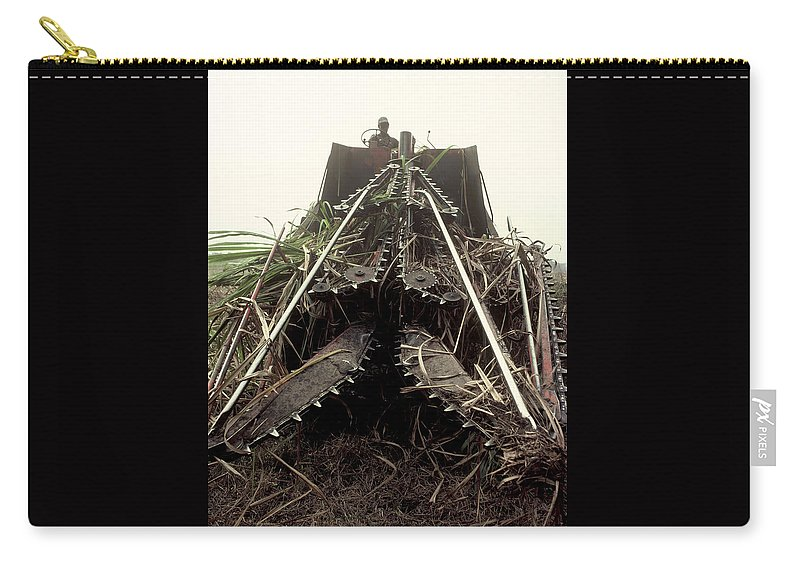 Sugar Cane Carry-all Pouch featuring the photograph Sugar Cane Cutter by Herman Robert