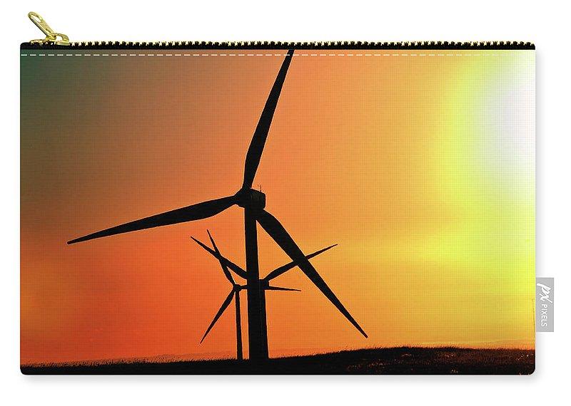 Sun Carry-all Pouch featuring the digital art Sun Glare Upon Alberta Windfarm by Mark Duffy