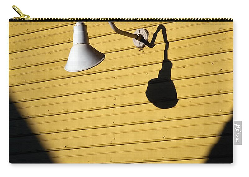 Sunlamp Carry-all Pouch featuring the photograph Sun Lamp by Dave Bowman