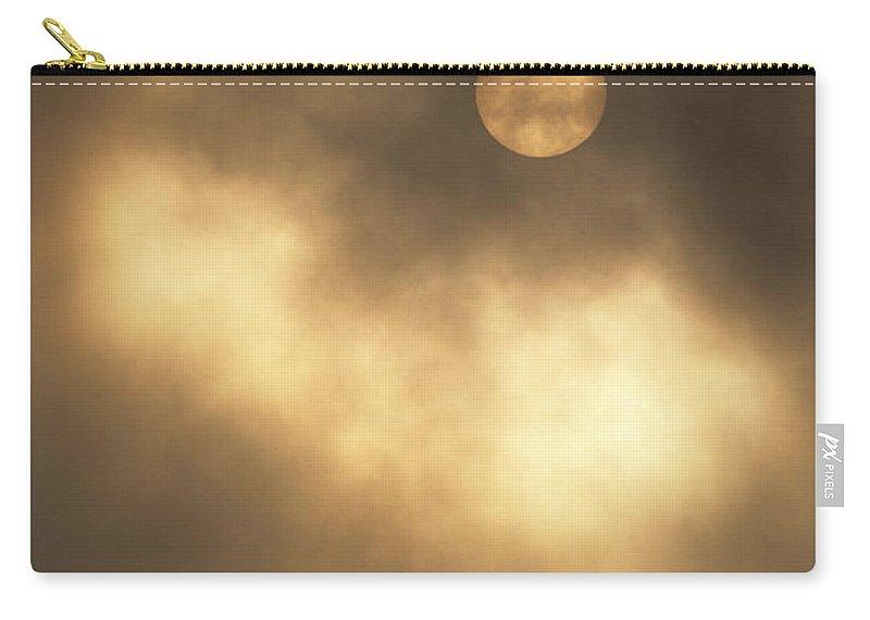 Sun Carry-all Pouch featuring the photograph Sun Rising Through Fog by John Harmon
