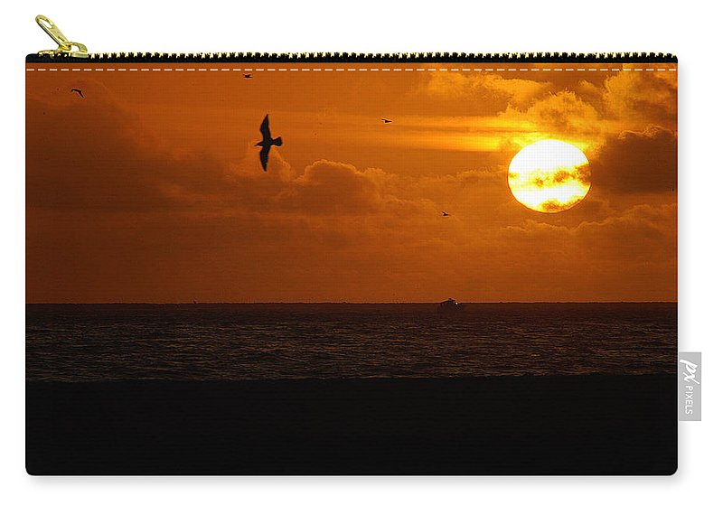 Clay Carry-all Pouch featuring the photograph Sundown Flight by Clayton Bruster