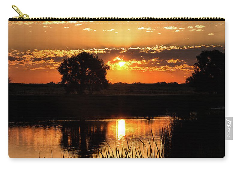 Sunrise Carry-all Pouch featuring the photograph Sunrise's Crepuscular Rays by Tony Hake