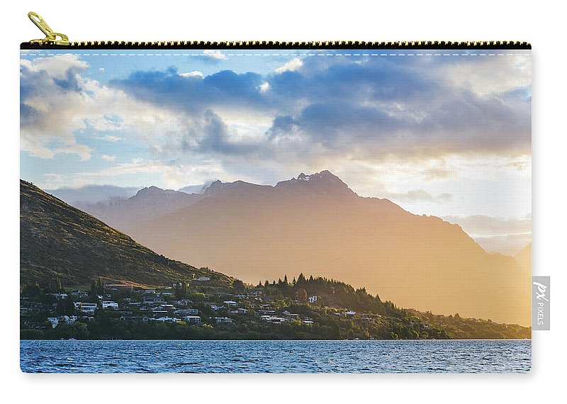 Mountain Carry-all Pouch featuring the photograph Sunset At The Lake by Chris Greig