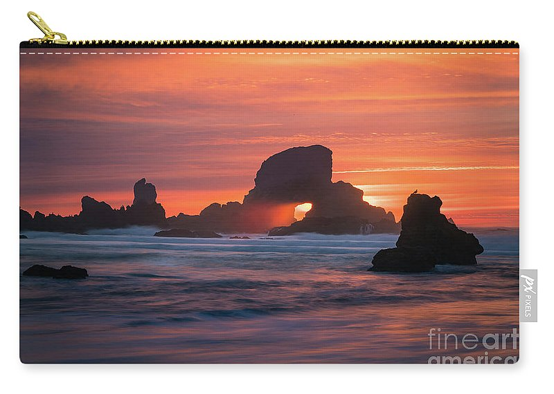 America Carry-all Pouch featuring the photograph Sunset Behind Arch At Oregon Coast Usa by William Freebilly photography