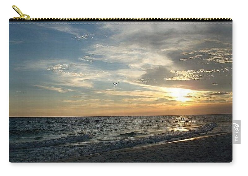Beach Carry-all Pouch featuring the photograph Sunset Flight by Inspired Arts