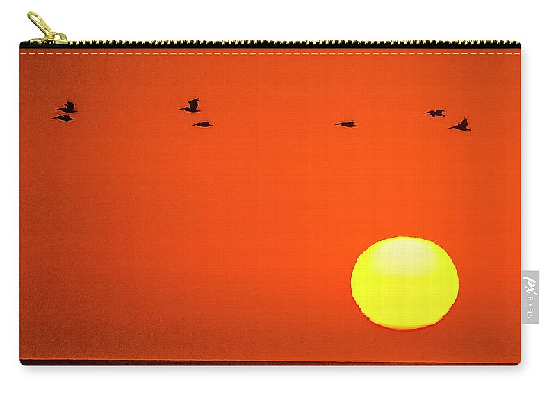 Ocean Carry-all Pouch featuring the photograph Sunset by James Burton
