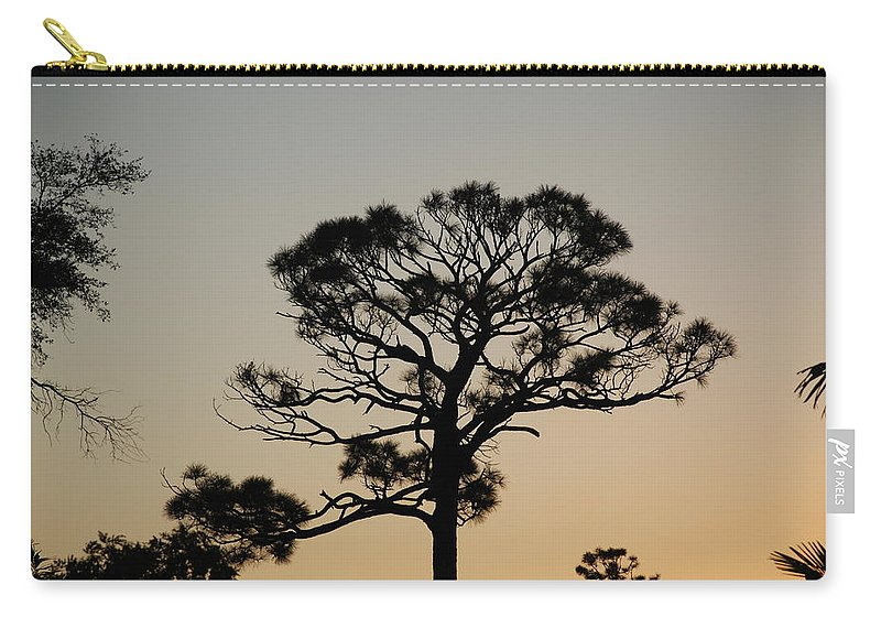 Tree Carry-all Pouch featuring the photograph Sunsetting Thru The Trees by Rob Hans