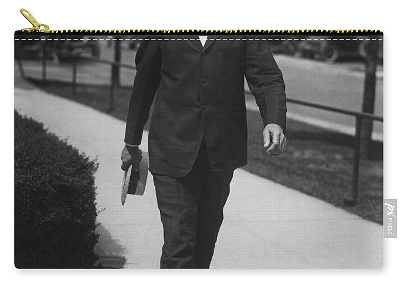 1 Person Carry-all Pouch featuring the photograph Surgeon General Walks To Work by Underwood Archives