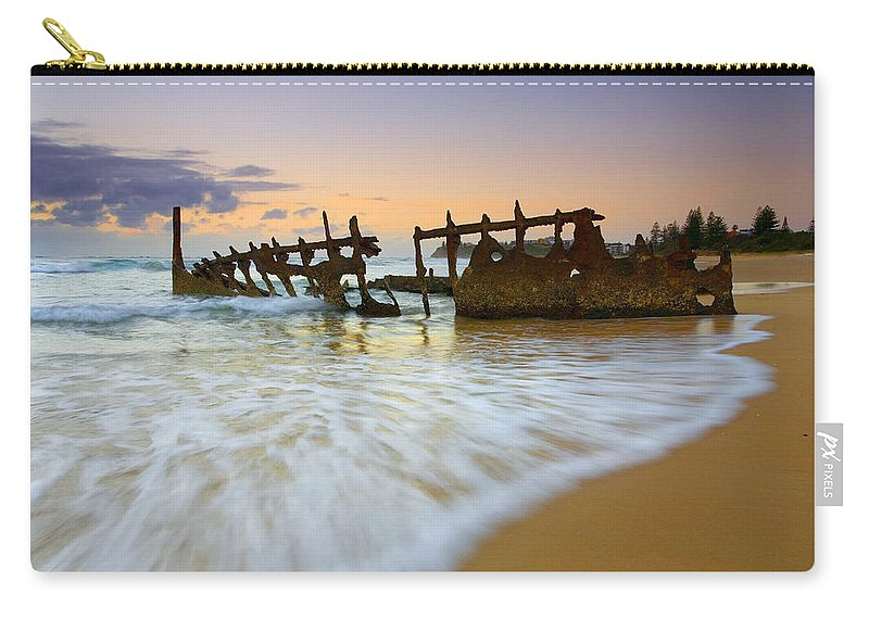 Shipwreck Carry-all Pouch featuring the photograph Swallowed By The Tides by Mike Dawson