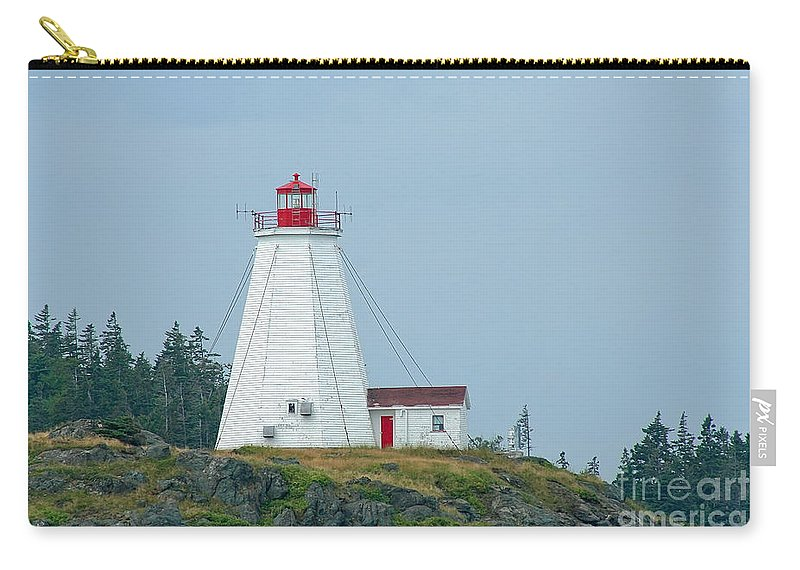 Lighthouse Carry-all Pouch featuring the photograph Swallowtail Lighthouse by Thomas Marchessault