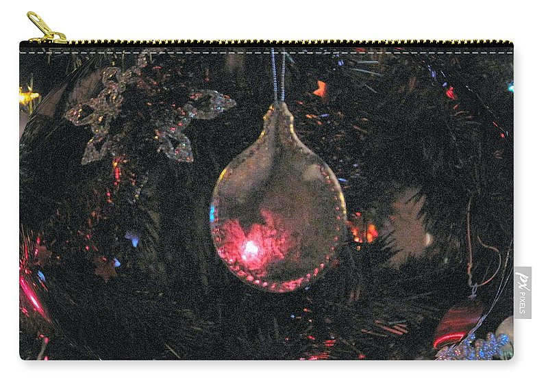 Christmas Carry-all Pouch featuring the photograph Symbol by Ian MacDonald
