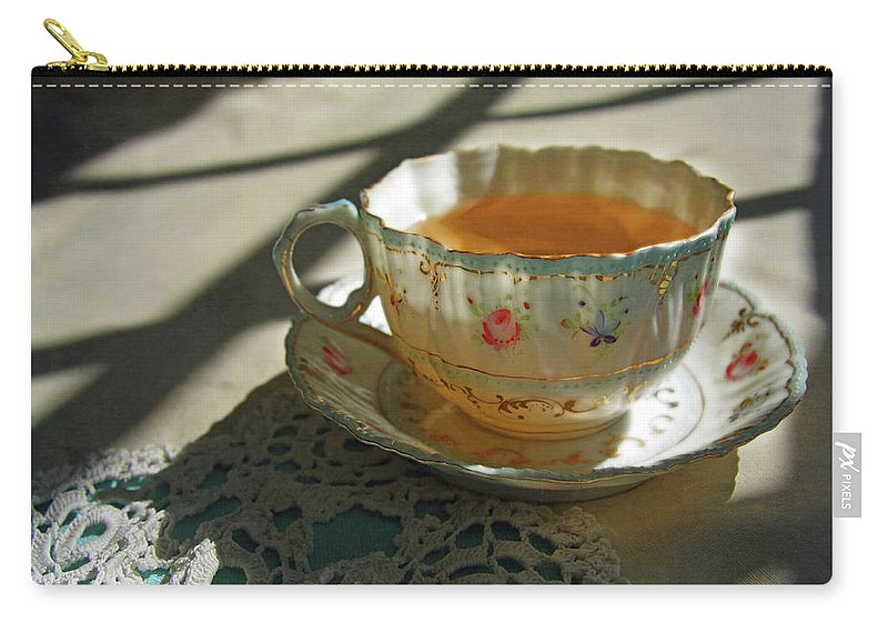 Tea Carry-all Pouch featuring the photograph Teacup On Lace by Brooke T Ryan